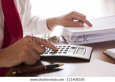 Business men working with documents and calculator  in the office - stock photo