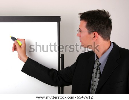 Business men write with pencil on the whiteboard
