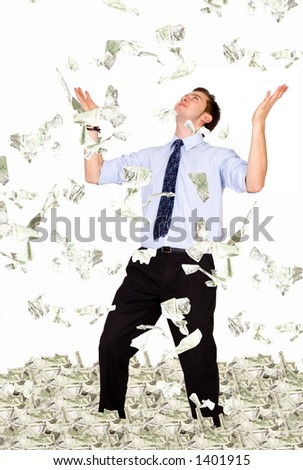 business millionaire - dollar bills raining on him - stock photo