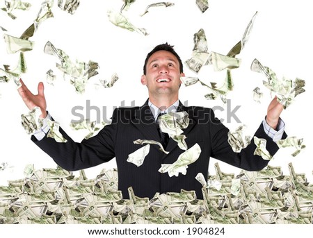 business millionaire over white - dollars coming down - stock photo