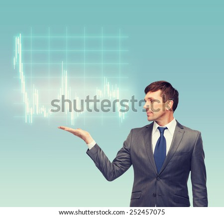 business, money and office concept - attractive buisnessman or teacher in suit showing forex chart on the palm - stock photo