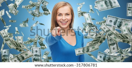 business, money, finance, people and gesture concept - smiling woman with dollar cash money pointing finger on you over blue background - stock photo