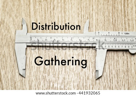 Business motivation and finance concept, vernier caliper with word DISTRIBUTION vs GATHERING over wooden floor and alphabetical word made from wood background