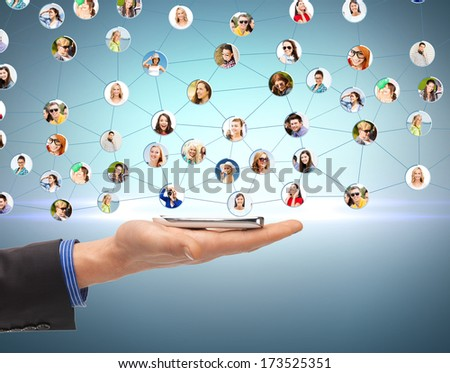 business, networking and communication - closeup of man hand with smartphone and social network