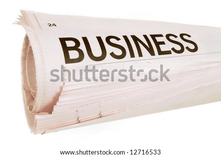 Business news headline on a rolled up newspaper isolated on white background