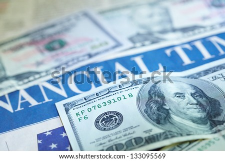Business newspaper with money - stock photo