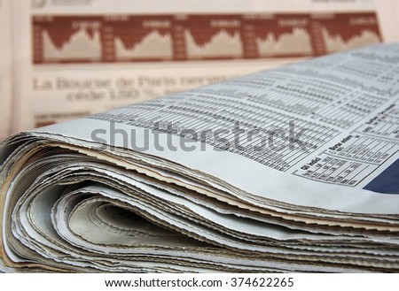 Business newspapers. Shallow depth of field. Focus on the foreground.