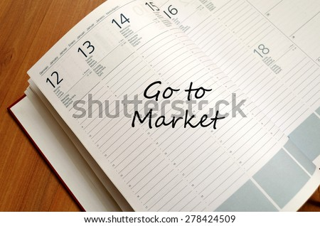 Business Notepad on wooden table Got to market concept - stock photo