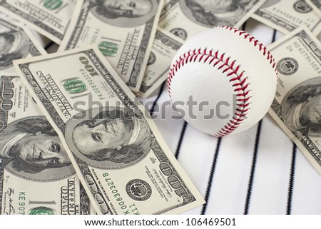 Business of baseball and money. Focus is on baseball. - stock photo