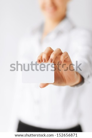 business, office, advertisement concept - businesswoman showing blank card - stock photo