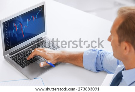business, office and money concept - smiling businessman working with forex chart in office - stock photo