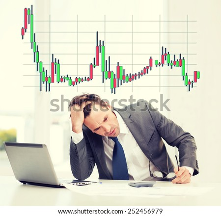 business, office and money concept - stressed businessman in black eyelgasses with laptop computer, papers, calculator and forex chart - stock photo
