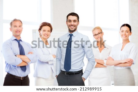business, office and people concept - group of smiling businessmen in office - stock photo