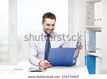 business, office and technology concept - smiling businessman with folder and tablet pc computer at office - stock photo