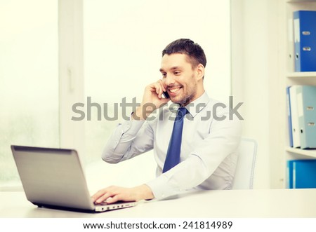 business, office and technology concept - smiling businessman with laptop computer and smartphone at office