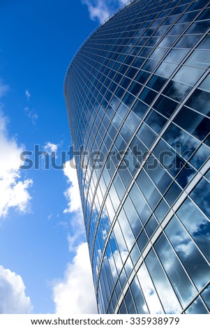 business office building exterior against blue sky - stock photo