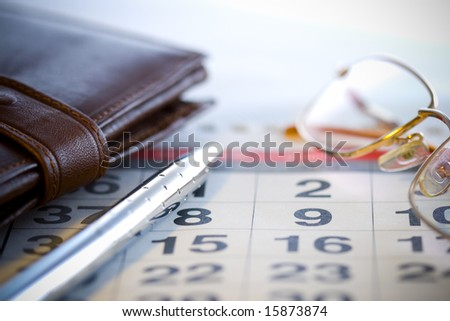 business office concept with glasses pen and purse