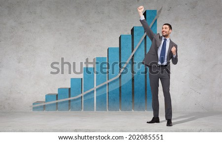 business, office, growth or success concept - happy businessman with hands up celebrating victory in front of the concrete wall with graph - stock photo