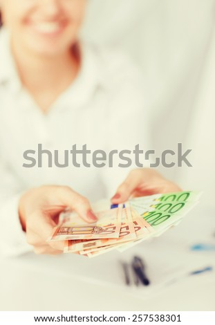 business, office, household, banking, tax, gambling concept - woman hands with euro cash money - stock photo