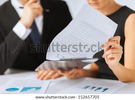business, office, law and legal concept - picture of man and woman hand signing contract paper - stock photo