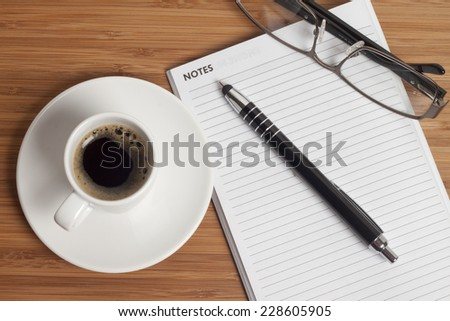 Business Office scenario, keyboard, pencil and coffee on work surface - stock photo