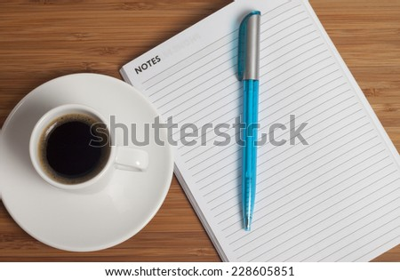 Business Office scenario, Note Pad, pencil and coffee on work surface - stock photo