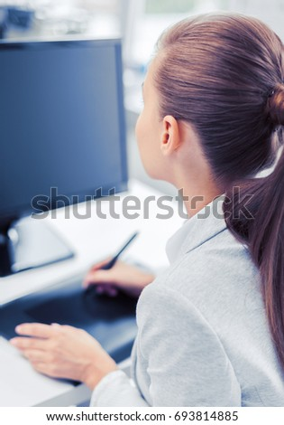 business, office, school and education concept - smiling businesswoman with drawing tablet in office