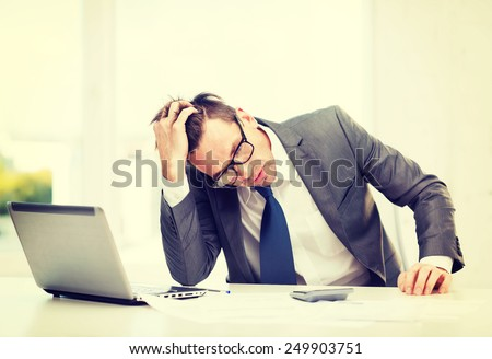 business, office, school and education concept - stressed businessman with laptop computer, papers and calculator - stock photo