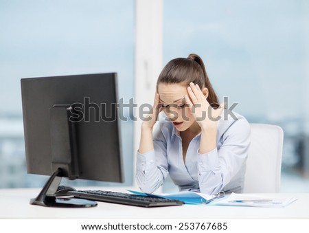 business, office, school and education concept - stressed businesswoman with computer and documents at work - stock photo