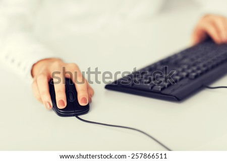 business, office, school and education concept - woman hands with keyboard and mouse - stock photo