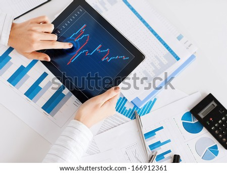 business, office, school and money concept - woman with chart paper, tablet pc and forex chart in it - stock photo