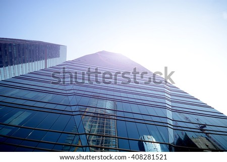 Business office skyscrapers, looking up at high-rise buildings in commercial district, architecture raising to the blue sky with white clouds, bottom view  - stock photo