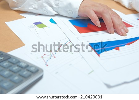 business, office, tax, school and education concept - woman hands with charts and papers  - stock photo
