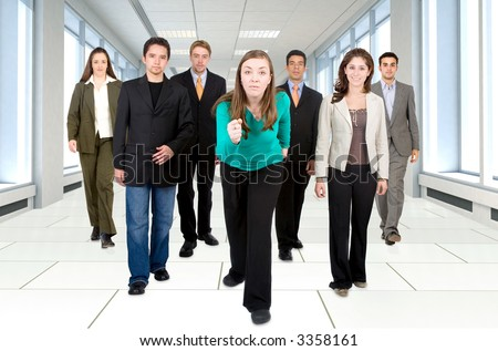 business office team going for success - all young and successful businessmen and businesswomen walking on a corridor - stock photo
