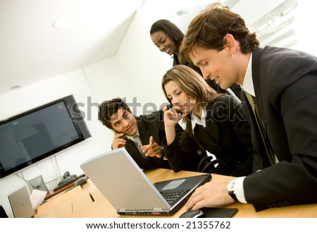 business office team meeting on a laptop - stock photo
