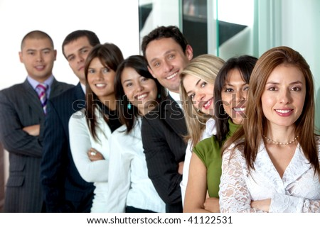 Business office team work - all young and successful businessmen and businesswomen - stock photo