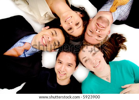 business office team work - all young and successful businessmen and businesswomen with heads together - stock photo