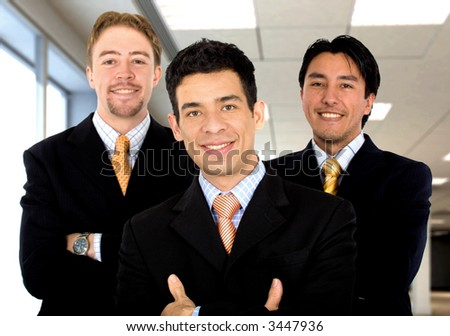 Business office teamwork where there are only men - all smiling - stock photo