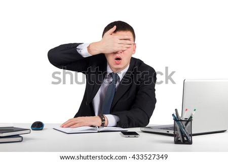 Business,office, technology, finances and internet concept-Frustrated businessman close his eyes by hand isolated on white background