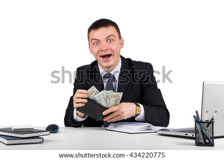 Business,office, technology, finances and internet concept -funny young screaming successful caucasian businessman in black suit holding money - stock photo