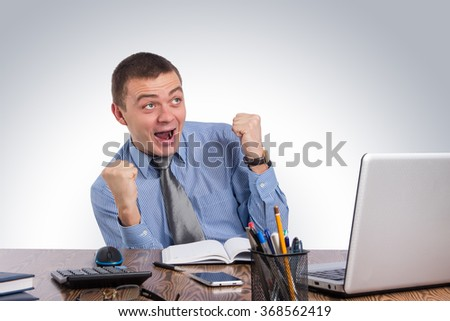 Business,office,technology, finances and internet concept - Smiling businessman with laptop computer and documents at office - stock photo