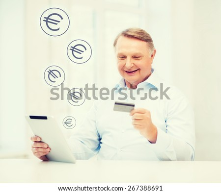 business, oldness, online banking, internet shopping and oldness concept - smiling old man with tablet pc and credit card at home - stock photo