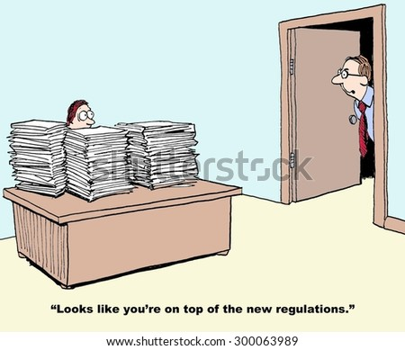 Business or industrial cartoon showing manager with stacks and stacks of paper on his desk and boss saying, 'looks like you're on top of the new regulations'.