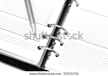 Business organizer and silver pen, high key - stock photo