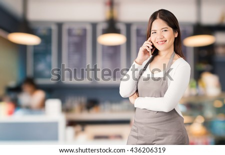 business owner with bakery shop background