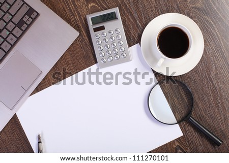 Business papers and a cup of coffee on the table - stock photo