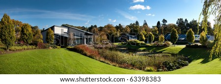Business park in ideal location to have perfect work-life balance with lush green grounds and energy efficient buildings - stock photo
