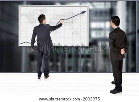 business partners analysing a graph in a corporate environment - stock photo