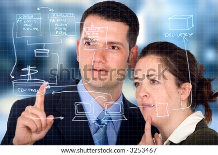 business partners analyzing a database structure in an office - stock photo
