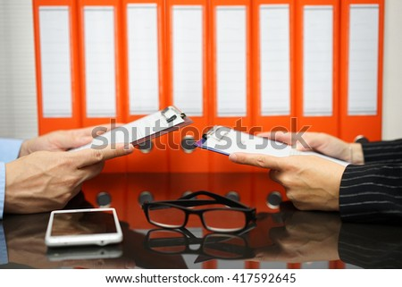 business partners are reading contract with documentation in background - stock photo